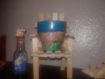 Clothespin chair with small flower pot sitting on top