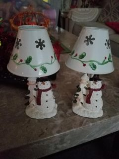 2 snowmen candle holders