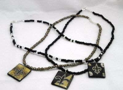 New Orleans Saints wood tile necklaces. Sold individually