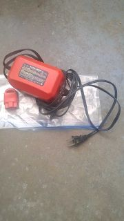 Lawn mower wall charger and key