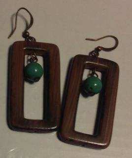 Neat brown rectangular longer earrings with blue green bead