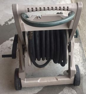Plastic resin Suncast brand hose reel with two hoses totaling 120+ feet of hose $40 for all.