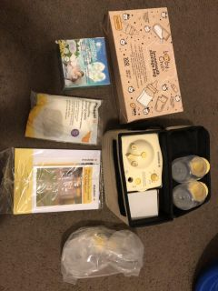 Brand new, never used Medela pump in style advanced and other accessories