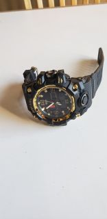 Smael black and gold multi-function watch.