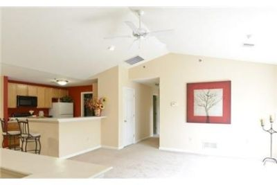 2 bedrooms Apartment - The open style kitchen features breakfast bar counter-tops.