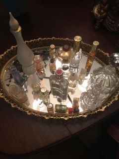 19 small and medium perfume bottles , 1 cologne bottom and mirrored tray