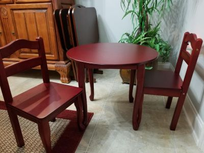 Adorable cherry wood kids table and chairs. Excellent condition.