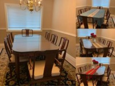 Solid wood dining table with 8 chairs 2 leaves