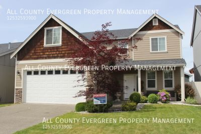 Lovely 4bd, 2.5 ba Puyallup Home with Custom Finishes!