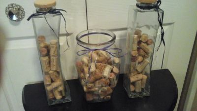 Three Glass Containers With Wine Bottle Corks