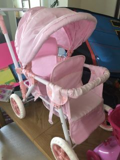 Pink double baby doll stroller