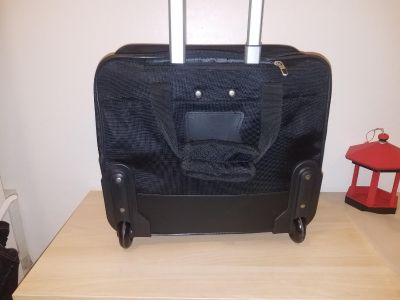 Lap top bag ,or home work back pack on wheels,has a foam pad to protect your computer, front pocket for supply's