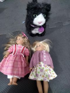 Two small American Girl dolls and Cat