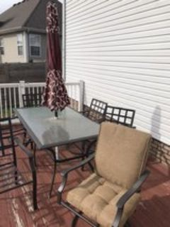 patio table. 6 chairs, 12 cushions, umbrella, covers