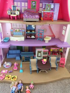 Fisher price dollhouse and accessories and car.