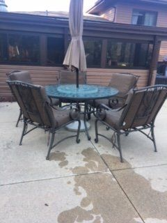 Outdoor Patio Table and 5 chairs with brown cushions and protective weather cover