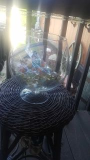 Betta fish bowl with glass rocks food and water drops