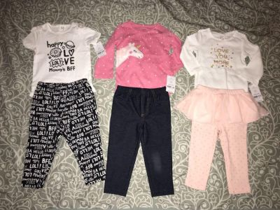 Brand new with tags from Carters, size 12 months. (Blur on camera lens on middle pants).