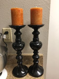 Black tall candle holders with new candles