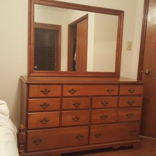 Maple bedroom set includes bed, night stand, dresser, and chair