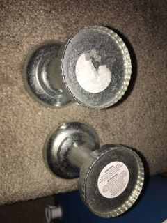 BNWT SMALL ALUMINUM CANDLE HOLDERS.