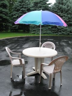 Patio Table , Chairs and Umbrella
