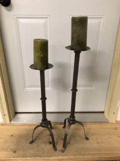 Two metal candle stands with Pillar candles.