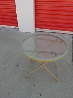 small round folding outdoor table