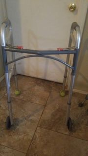 Collapsible Walker with adjustable height $15
