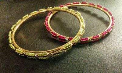 Beautiful gold bracelets with red green glass beads