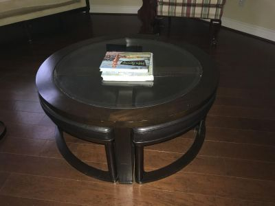 Unique round coffee table with pullout wedge seating