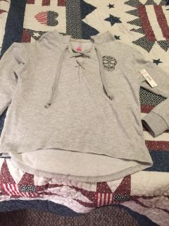 Juniors size medium brand new with tags sweatshirt material shirt. Little longer in back