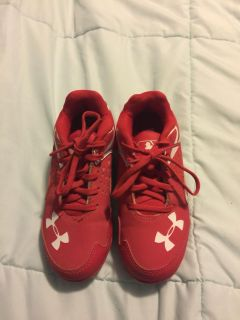 Under Armour red child s baseball cleats size 12