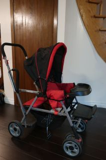 Red and Black Double Stroller