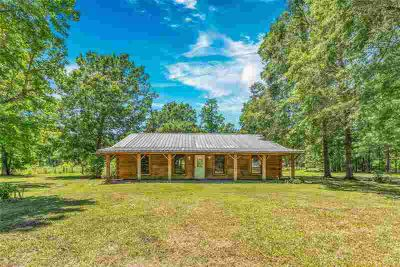 687 County Road 2147 Cleveland Three BR, This charming log home
