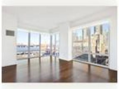 Luxury converted Two BR/1.5 BA corner apartment boasts river views with north