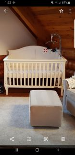 White crib, dresser and mattress