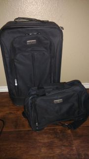 Small carry on suitcase and toiletries bag