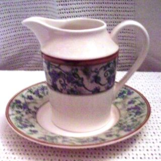 # 20 White China Creamer & Saucer