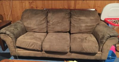Microfiber couch. Lots of life left in this super comfy couch. Brown microfiber. Has rip where cushion attaches, but barely visible