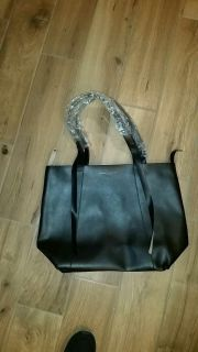 Donna Karen tote/purse new with tags. Measures 19 x 14.