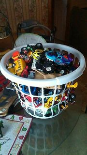 Big basket of match box cars fourwheelers monster trucks dirt bikes trailers and more.......