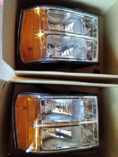 $100 GMC Sierra Headlight Assembly (2)