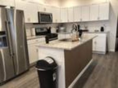 Roommate wanted to share Four BR Four BA Townhouse...