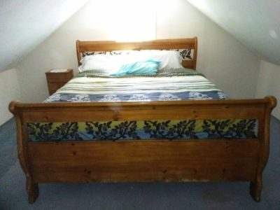 King Sized Bed with Wood Frame