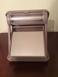 Clairol Folding Lighted Make-up Mirror. Works. Needs batteries. 6.6 x 7.5 inches folded.