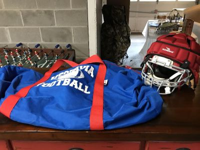 Football helmet with Guardian shock absorber and equipment bag