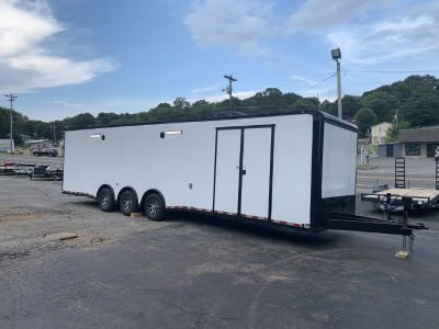 NEW 2020 OUTLAW ENCLOSED RACE TRAILER- triple spread axle