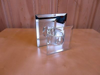 mirrors and glass candle holder