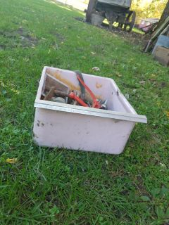 Old pink icebox drawer filled with items